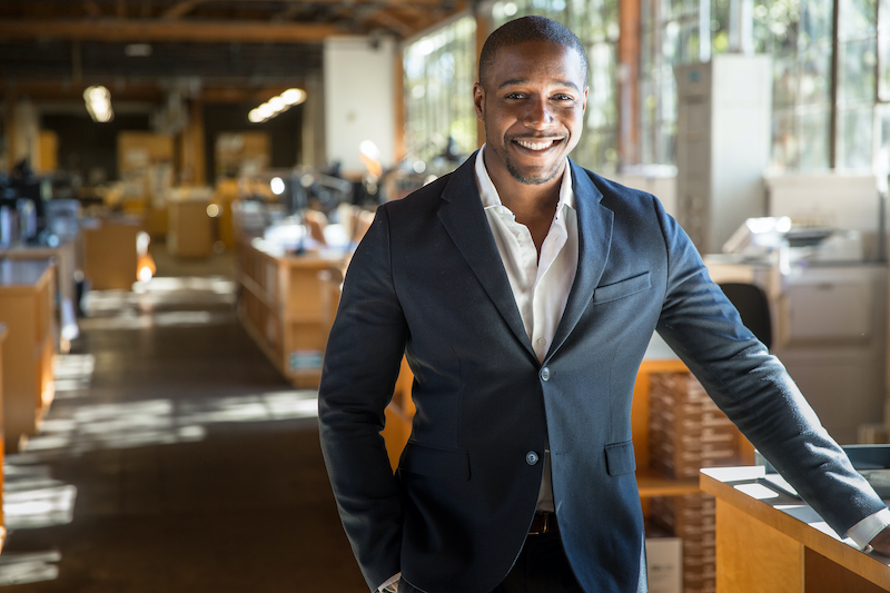 Business owner smiling because business is growing